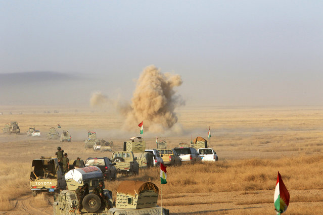 Military vehicles of the Kurdish Peshmerga forces are seen on the southeast of Mosul , Iraq, August 14, 2016. (Photo by Azad Lashkari/Reuters)