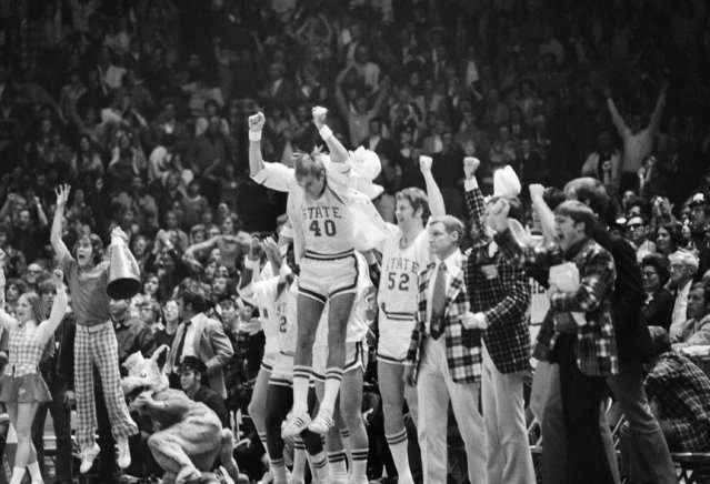 In this March 23, 1974, file photo, North Carolina State's Mark Noeller (40) jumps into the air as they defeat UCLA 80-77 in double overtime in a semifinal game at the NCAA college basketball championships in Greensboro, N.C. (Photo by AP Photo/File)