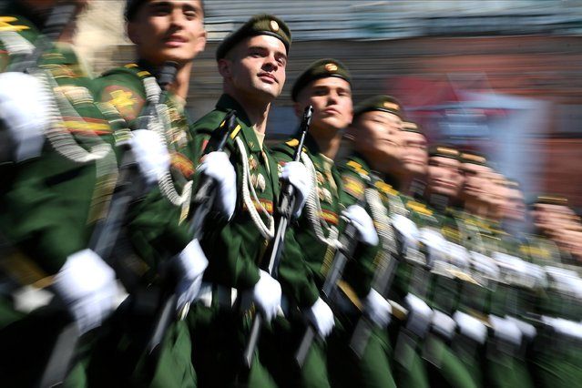 Russian servicemen march during the Victory Day Parade in Red Square in Moscow, Russia, June 24, 2020. (Photo by Ramil Sitdikov/Host Photo Agency via Reuters)