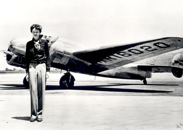 Undated picture taken in the 30' s of American female aviator Amelia Earhart in front of her plane. Amelia Earhart was the first woman to fly the Atlantic as a passenger, in 1928, and followed this by a solo flight in 1932. In 1935 she flew solo from Hawan to Califofrnia. In 1937, with Fred Noonan, they set out to fly round the world, but their plane was lost over the Pacific, 02 July. (Photo credit should read STAFF/AFP/Getty Images)