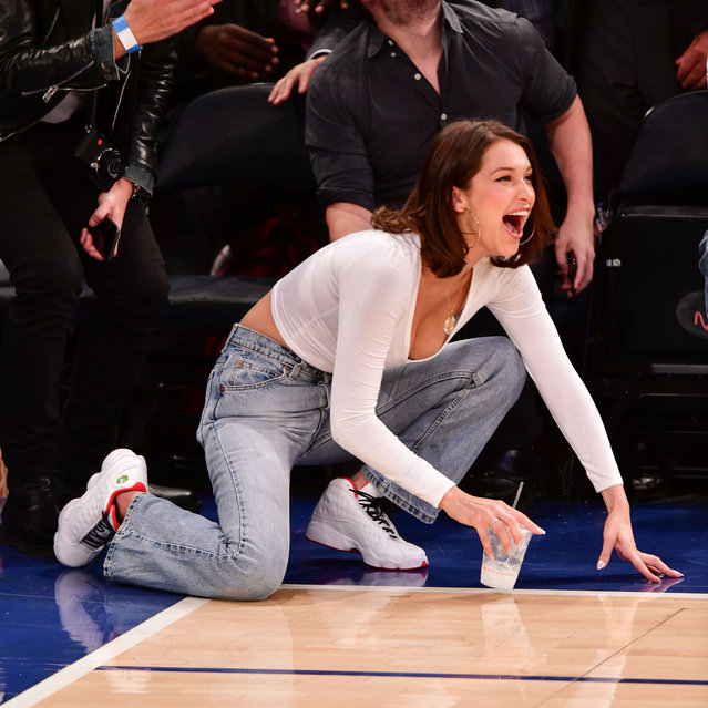 Bella Hadid attends the Los Angeles Lakers Vs New York Knicks game at Madison Square Garden on December 12, 2017 in New York City. (Photo by James Devaney/Getty Images)