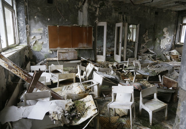 An abandoned kindergarten in the deserted city of Pripyat, which was built to house the workers of the Chernobyl nuclear power station some 3 kilometers (1.86 miles) from the plant, November 27, 2012. (Photo by Efrem Lukatsky/AP Photo)