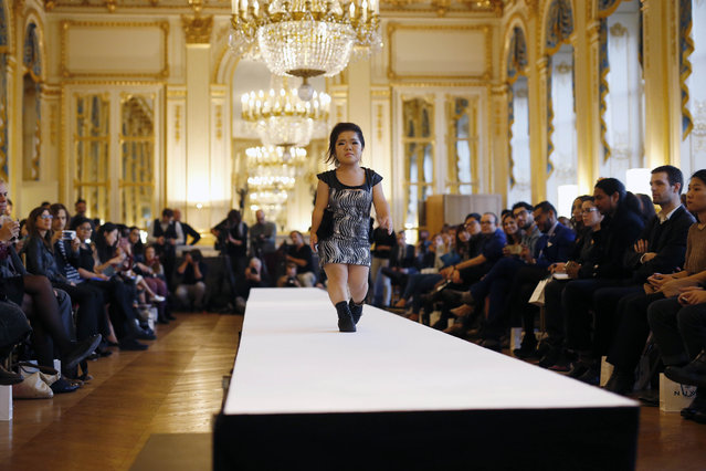 A model hits the catwalk at the French Ministry of Culture during the dwarf fashion show  in Paris, France, Friday October 2, 2015. (Photo by Jerome Delay/AP Photo)