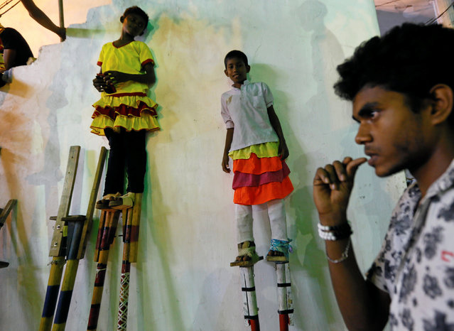 Sri Lankan traditional stilt walkers waits for the start of the annual Perahera (street pageant) at Rajamaha viharaya Buddhist temple in Colombo, Sri Lanka September 10, 2016. (Photo by Dinuka Liyanawatte/Reuters)