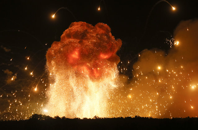 A powerful explosion is seen in the ammunition depot at a military base in Kalynivka, west of Kiev, Ukraine, early Wednesday, September 27, 2017.  Ukrainian officials say they have evacuated more than 30,000 people after a fire and ammunition explosions, at the military base. (Photo by Efrem Lukatsky/AP Photo)