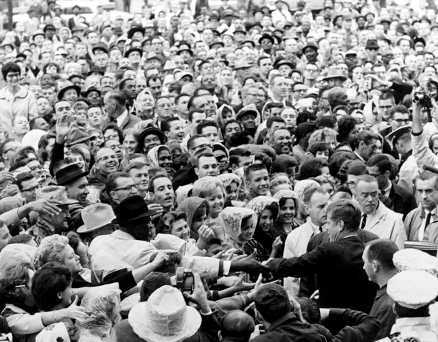 President John F. Kennedy greets a crowd at a political rally in Fort Worth, Texas in this November 22, 1963 photo by White House photographer Cecil Stoughton. (Photo by Cecil Stoughton/Reuters/JFK Library/The White House)