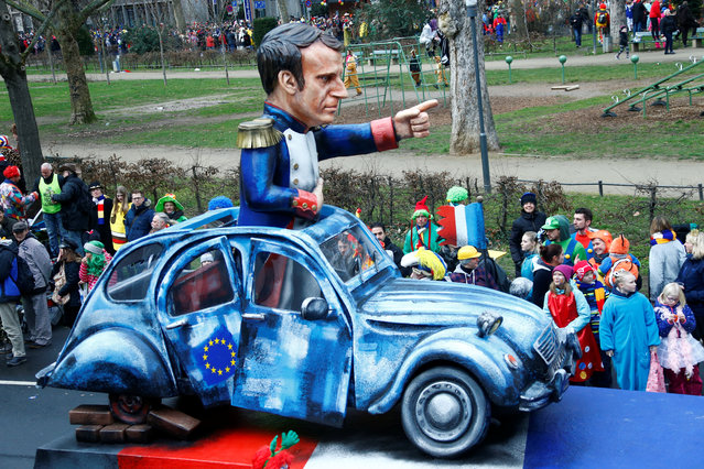 """A carnival float depicting French President Emmanuel Macron at the traditional """"Rosenmontag"""" Rose Monday carnival parade in in Mainz, Germany on February 12, 2018. (Photo by Ralph Orlowski/Reuters)"""