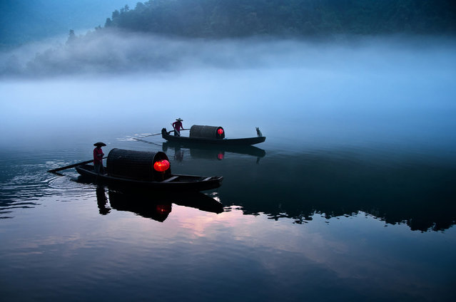 """River Ferry Operating in the Early Morning in Xiao Donjiang, China"". Photo by James Khoo (Shah Alam, Malaysia). Photographed in La Pan Tan, Mu Cang Chay, Yen Bai, Viet Nam, August 2010."
