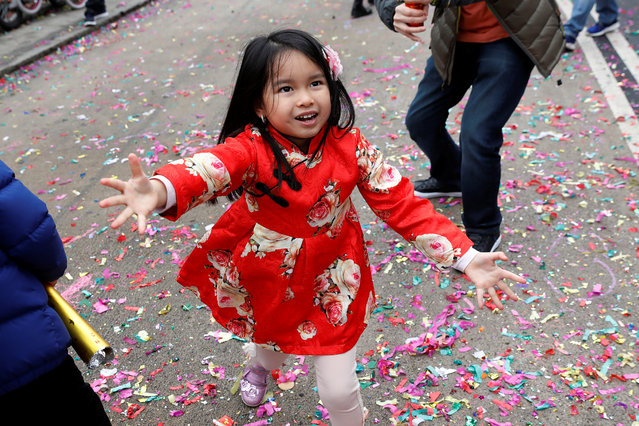 A child celebrates the Chinese Lunar New Year of the Dog in Manhattan's Chinatown in New York, February 16, 2018. (Photo by Shannon Stapleton/Reuters)