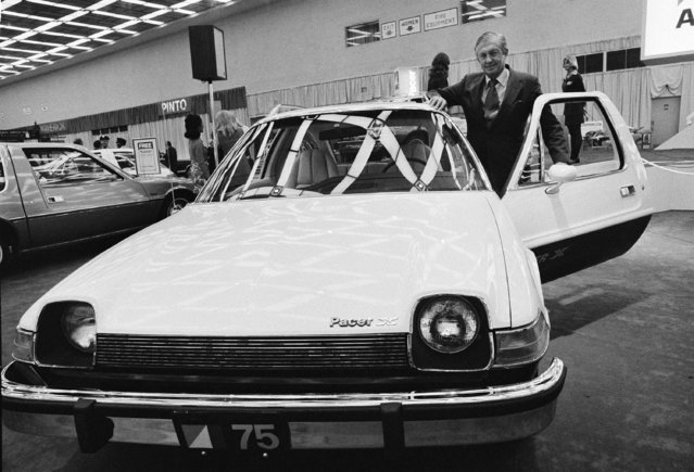 American Motors' board chairman Roy D. Chapin checks over the company's new sub-compact Pacer during a preview ceremony at the 1975 Detroit Auto Show, Jan. 12, 1975. (Photo by AP Photo)