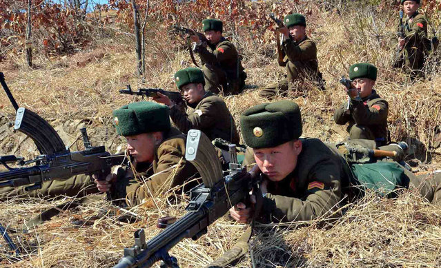 This picture, taken by North Korea's official Korean Central News Agency on March 20, 2013 shows North Korea's Korean People's Army soldiers at an undisclosed location in North Korea. Meanwhile, North Korea on March 21 threatened strikes on US military bases in Japan and Guam, escalating tensions as suspicion deepened that Pyongyang was behind a cyber attack on South Korean broadcasters and banks. (Photo by AFP Photo/KCNA via KNS)