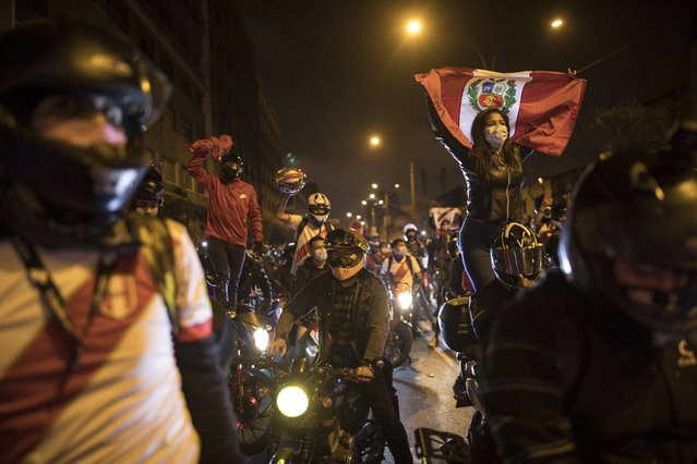 A caravan of demonstrators on motorcycles ride as they wait for news on who will be the country's next president, in Lima, Peru, Sunday, November 15, 2020. Manuel Merino announced his resignation following massive protests, unleashed when lawmakers ousted President Martin Vizcarra. (Photo by Rodrigo Abd/AP Photo)