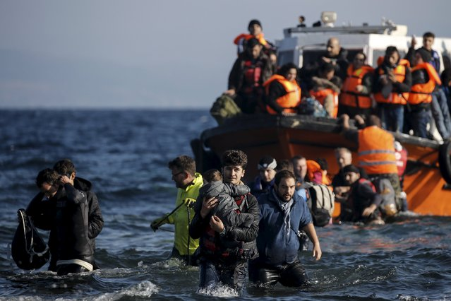 Refugees and migrants arrive on a boat on the Greek island of Lesbos, November 7, 2015. Since the start of the year, over 590,000 people have crossed into Greece, the frontline of a massive westward population shift from war-ravaged Syria and beyond. (Photo by Alkis Konstantinidis/Reuters)