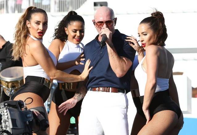 """Armando Christian Perez """"Pitbull"""" performs onstage at the Christening Ceremony for Norwegian Cruise Line's newest ship Norwegian Escape at Port Miami on November 9, 2015 in Miami, Florida. (Photo by Alexander Tamargo/Getty Images for Norwegian Cruise Line)"""