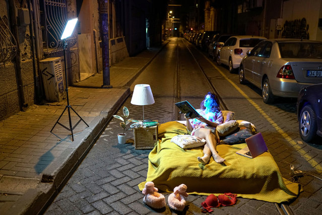 Artist Sayna Soleimanpour performs a photoshoot in protest against the mistreatment and alienation of Turkish women based on their clothing, during a two-day curfew amid the spread of the coronavirus disease (COVID-19), on a deserted street in Istanbul, Turkey, early December 6, 2020. (Photo by Umit Bektas/Reuters)