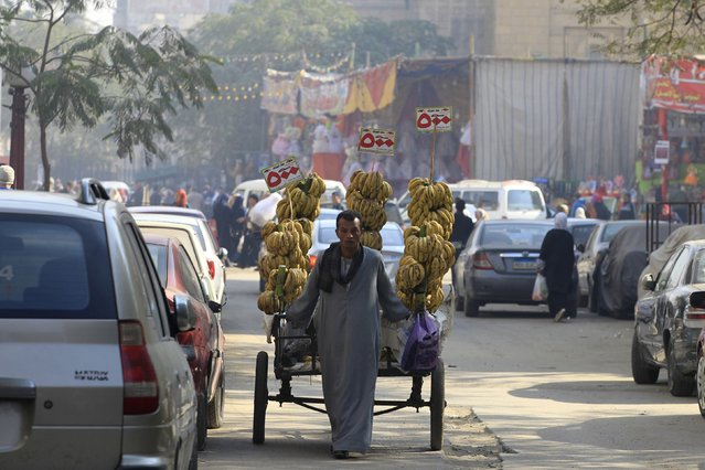 A  street vendor sells bananas close to a market in Cairo, December 30, 2014. (Photo by Mohamed Abd El Ghany/Reuters)