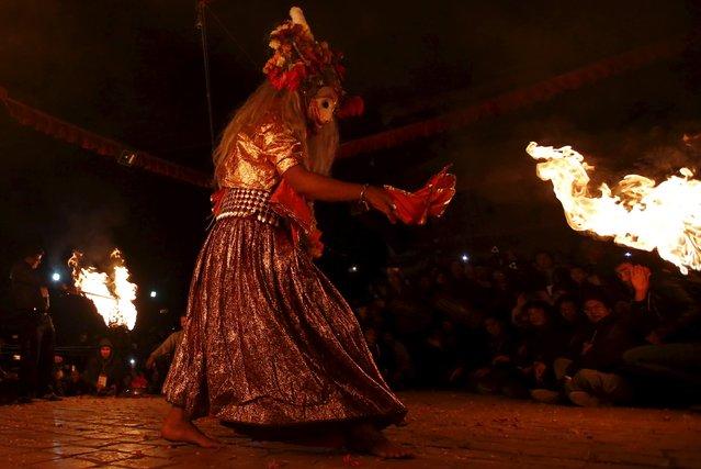 "A medium performs the religious dance ""Narsingh Avatar"" during the traditional Kartik dance festival at Patan Durbar Square in Lalitpur, Nepal November 24, 2015. (Photo by Navesh Chitrakar/Reuters)"