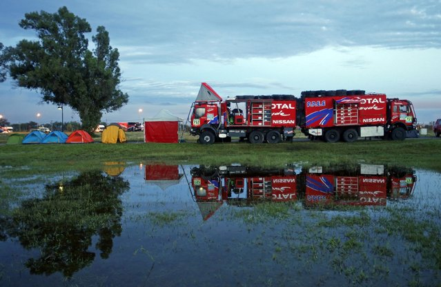 Team trucks are seen at the bivouac early morning before the 11th stage of the Dakar Rally 2015 from Cachi to Termas de Rio Hondo January 15, 2015. (Photo by Jean-Paul Pelissier/Reuters)