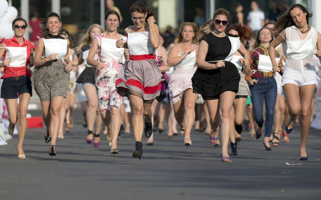 Women compete in a high heels race organized by a fashion magazine in Bucharest, Romania, Tuesday, June 25, 2013. (Photo by Vadim Ghirda/AP Photo)