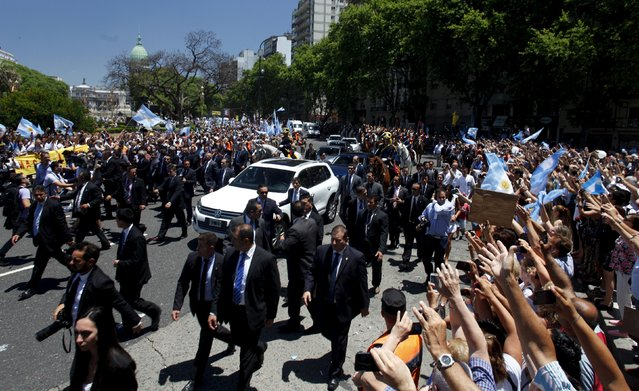 Argentina's President Mauricio Macri's car is surrounded by security as he leaves after being sworn-in to office at the Argentine Congress in Buenos Aires, December 10, 2015. (Photo by Martin Acosta/Reuters)