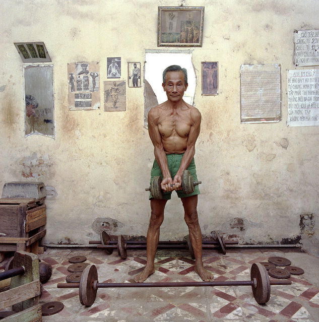 "Man lifting weights. (Photo by  William E. Crawford from the book ""Hanoi Streets 1985-2015: In the Years of Forgetting"")"