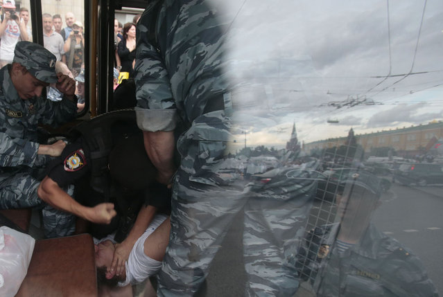 A policeman beats a man, who was detained, inside a police bus during a protest against the verdict of a court in Kirov, which sentenced Russian opposition leader Alexei Navalny to five years in jail, in central Moscow, July 18, 2013. Navalny was sentenced to five years in jail for theft on Thursday, an unexpectedly tough punishment which supporters said proved President Vladimir Putin was a dictator ruling by repression. (Photo by Tatyana Makeyeva/Reuters)
