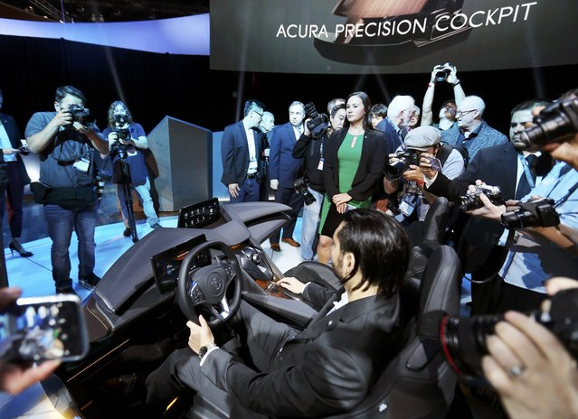 Media members take photos as Acura introduces its Acura Precision cockpit design at the 2016 Los Angeles Auto Show in Los Angeles, California, U.S November 16, 2016. (Photo by Mike Blake/Reuters)