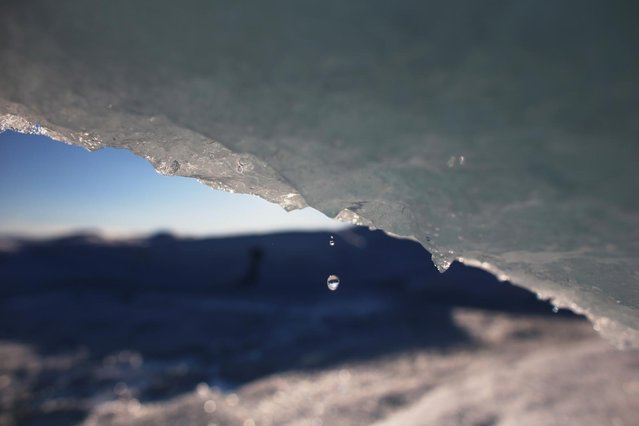 Part of the glacial ice sheet that covers about 80 percent of the country is seen on July 17, 2013 on the Glacial Ice Sheet, Greenland. (Photo by Joe Raedle/Getty Images via The Atlantic)