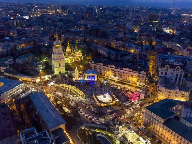 St. Sophia Square is illuminated to mark the upcoming New Year and Orthodox Christmas celebrations in Kiev, Ukraine, Sunday, December 27, 2015, with St. Sophia Cathedral on the center left. (Photo by Evgeniy Maloletka/AP Photo)
