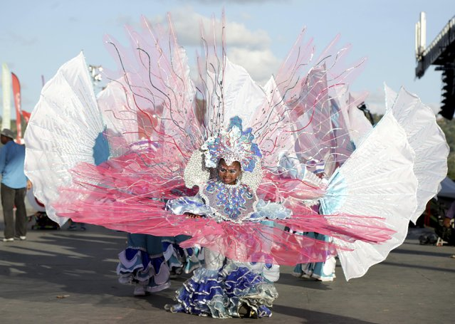 A reveller from the band Play One For Cito parades on stage at the annual Trinidad and Tobago Red Cross Society's Children's Carnival Competition at the Queen's Park Savannah in Port-Of-Spain February 7, 2015. (Photo by Andrea De Silva/Reuters)