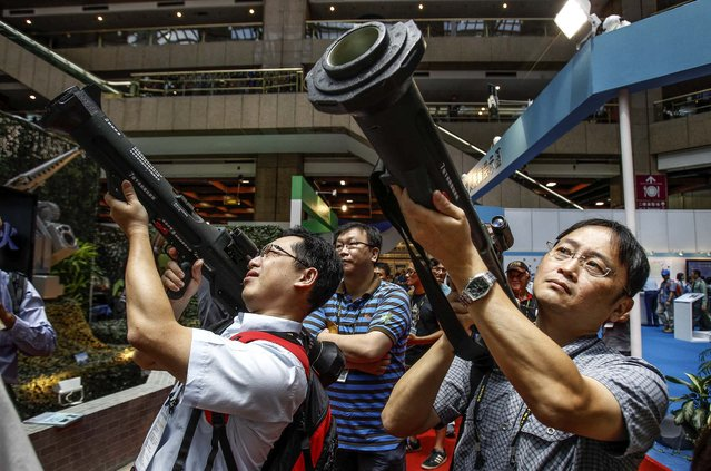Visitors to the Taiwan Aerospace & Defense Technology Expo aim shoulder-fired Kestrel HEAT Rockets in Taipei, Taiwan, on August 16, 2013. (Photo by Wally Santana/Associated Press)