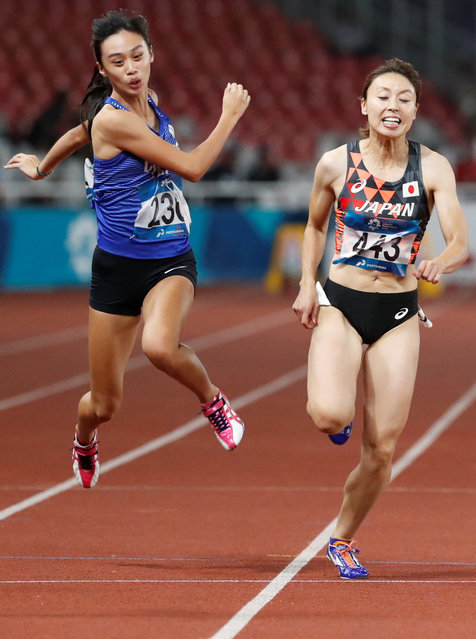 Ichikawa Kana (right) of Japan and Chen Wanmei of Chinese Taipei in action during Women's 100m Qualification on day seven of the Asian Games on August 25, 2018 in Jakarta, Indonesia. (Photo by Darren Whiteside/Reuters)