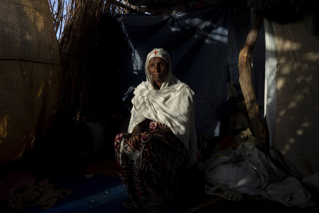 """Tigrayan refugee Maza Girmay, 65, sits in her shelter, in Hamdayet, eastern Sudan, near the border with Ethiopia, on March 15, 2021. """"I heard food was being distributed"""", she said. She went to the government office in her community of Bahkar to inquire. """"They told me, Go home, you're Tigrayan"""". The rejection brought her to tears. """"We Tigrayans are Ethiopian. Why do they treat us as non-Ethiopian?"""" she said. (Photo by Nariman El-Mofty/AP Photo)"""