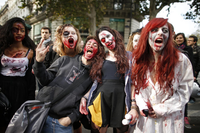 Women dressed as zombies participate in a Zombie Walk procession in the streets of Paris October 12, 2013. (Photo by Benoit Tessier/Reuters)