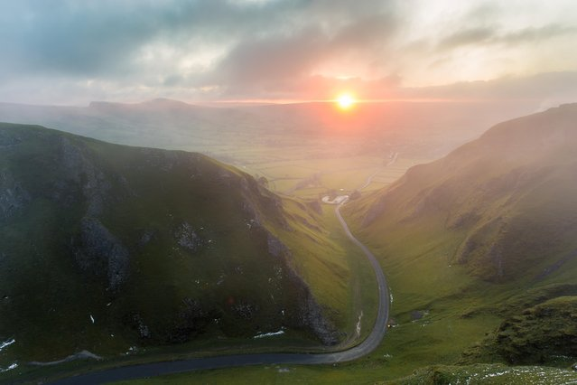 Misty sunrise at Winnat's Pass, Derbyshire on August 26, 2016. (Photo by Dave Zdanowicz/Rex Features/Shutterstock)