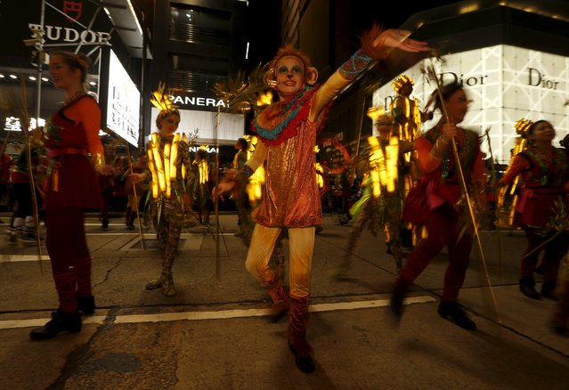 A performer dressed as a monkey takes part in a Lunar New Year parade in Hong Kong, China February 8, 2016 to celebrate the first day of the Lunar New Year of the Monkey. (Photo by Bobby Yip/Reuters)