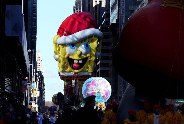 The SpongeBob SquarePants balloon floats down Sixth Avenue.  (Photo by Michelle V. Agins/The New York Times)