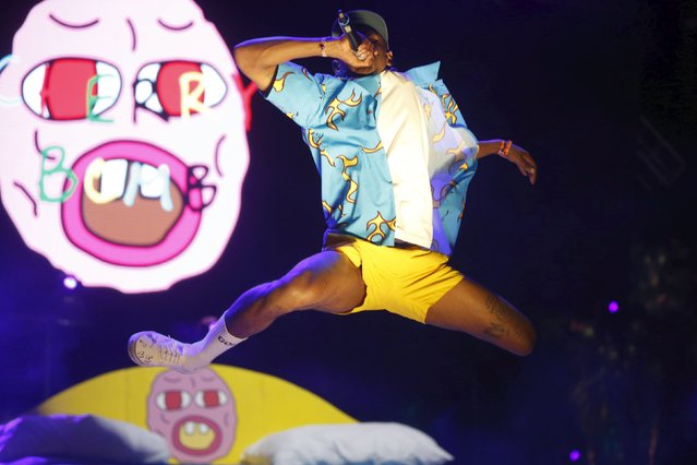 Tyler the Creator jumps off a stage set giant bed at the Coachella Valley Music and Arts Festival in Indio, California April 11, 2015. (Photo by Lucy Nicholson/Reuters)