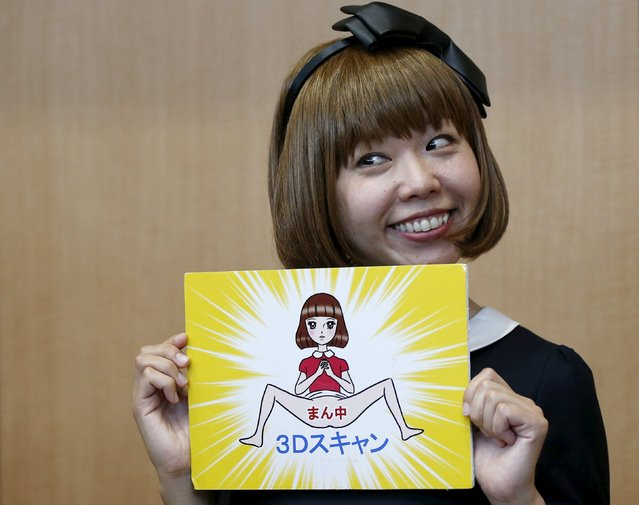 "Japanese artist Megumi Igarashi, known as Rokudenashiko, holds her artwork after a news conference following a court appearance in Tokyo April 15, 2015. A Japanese artist on trial for obscenity after making figurines and a kayak modeled on her v*gina said on Wednesday that there was nothing wrong with her artwork and her arrest merely showed how far Japan remains behind the west. Words in the artwork read ""Centre. 3D scan"". (Photo by Toru Hanai/Reuters)"