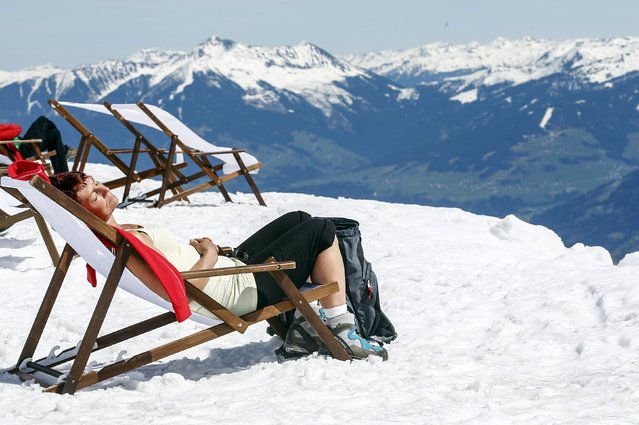 A woman lies on a sun chair on a sunny spring day at Seegrube mountain in Innsbruck April 15, 2015. (Photo by Dominic Ebenbichler/Reuters)