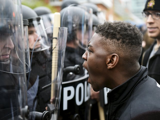 A demonstrator confronts police near Camden Yards during a protest against the death in police custody of Freddie Gray in Baltimore April 25, 2015. (Photo by Sait Serkan Gurbuz/Reuters)