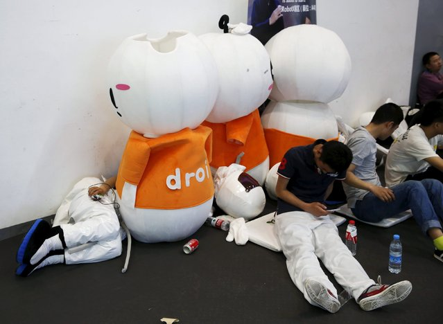 Promotional staff rest next to their mascot outfits at the Global Mobile Internet Conference (GMIC) 2015 in Beijing, China, April 28, 2015. (Photo by Kim Kyung-Hoon/Reuters)