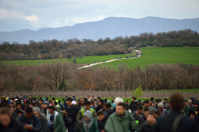 Refugees make their way to Macedonia from a makeshift camp at the Greek-Macedonian border, near the Greek village of Idomeni on March 14, 2016, where thousands of refugees and migrants are stranded by the Balkan border blockade. Over 1000 refugees left the Idomeni camp on March 14, at noon to find a way to Macedonia. (Photo by Daniel Mihailescu/AFP Photo)