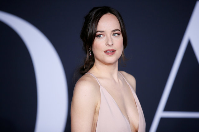 """Cast member Dakota Johnson pose at the premiere of the film """"Fifty Shades Darker"""" in Los Angeles, California, February 2, 2017. (Photo by Danny Moloshok/Reuters)"""