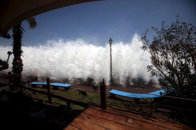A wave crashes on La Libertad malecon May 3, 2015. (Photo by Jose Cabezas/Reuters)