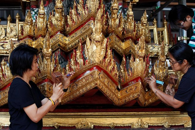 Thai officials from the Conservation Science Division of the Fine Arts Department of the National Museum of Thailand repairs the Minor Chariot, which will be used during the late King  Bhumibol Adulyadej's funeral later this year, Thailand, February 6, 2017. (Photo by Chaiwat Subprasom/Reuters)