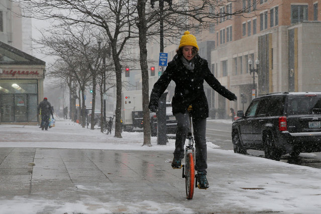 Rebecca Bailey rides a unicycle during a winter nor'easter snow storm in Boston, Massachusetts, U.S. February 9, 2017. (Photo by Brian Snyder/Reuters)