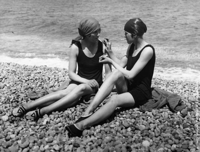 Two bathers enjoy a cigarette on the beach, 1926