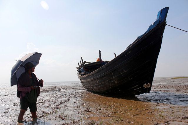 A stranded boat which was used by Rohingya Muslims is seen at the Thande village beach outside Yangon, Myanmar November 16, 2018. (Photo by Myat Thu Kyaw/Reuters)