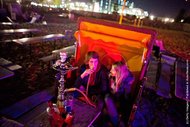 Guests spend the evening in the beach bars in Berlin, Germany